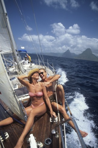 1990s-couple-sitting-on-bow-of-sailboat-saint-lucia-west-indies